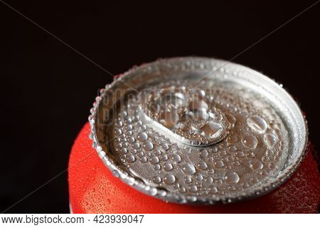 Close-up of a can of soda on a table.