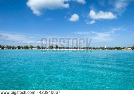 The View Of Turquoise Waters With Tourist Beach In A Background On Half Moon Cay (bahamas).