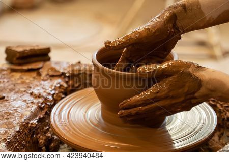 Hands Of A Potter, Creating An Earthen Jar On The Circle. Woman Makes Hand Made Ceramics From Clay