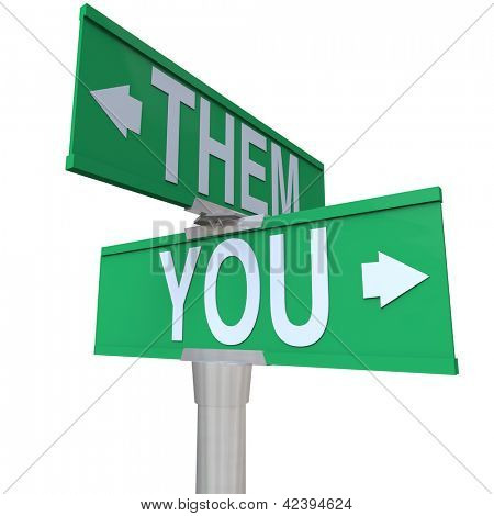 The words You and Them on a two-way street sign to symbolize choice between yourself and a competitor or opponent for a job or goal in business or life