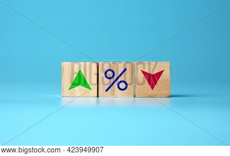 Interest Rate Financial And Mortgage Rates Concept. Wooden Cube Block With Icon Percentage, Arrow Up