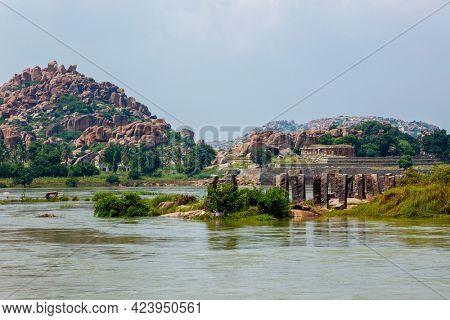 Ancient Vijayanagara Empire civilization ruins in Hampi near Tungabhadra river, Hampi, Karnataka, India