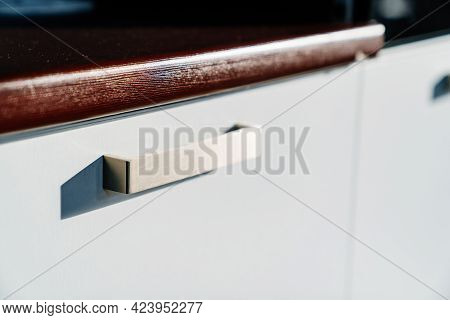Handle On White Doors Of Kitchen Cupboard. Furniture For Interior Of The House