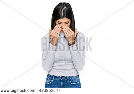 Beautiful brunette woman wearing casual clothes rubbing eyes for fatigue and headache, sleepy and tired expression. vision problem