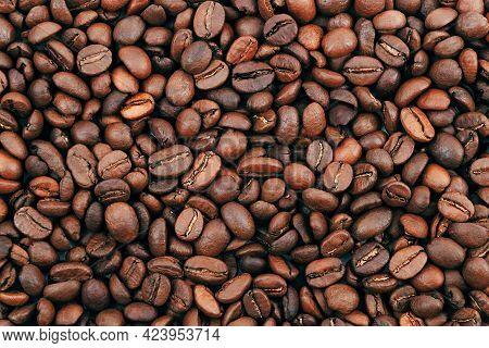 Coffee Bean Background. Dark, Brown Roasted Coffee Beans. Scattered Coffee Beans. Background For Adv