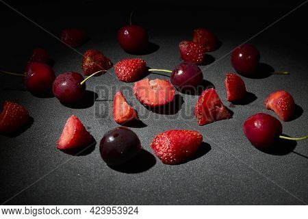 Summer Fruit, Several Cherries And Strawberries On A Table