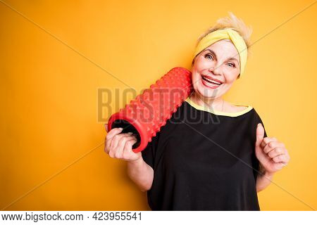 Happy Elderly Woman In Black T-shirt Holding Fascia For Exercise Smiling And Laughing