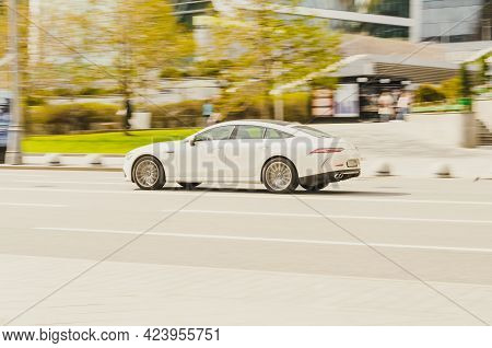 Moscow, Russia - May, 2021: Side View Of White Mercedes Amg Gt 4-door Coupe. Fast Moving Car On The