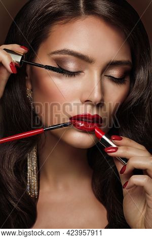 Woman Applying Make Up. Beauty Model Girl Put On Red Lipstick. Professional Makeup Artist Painting L