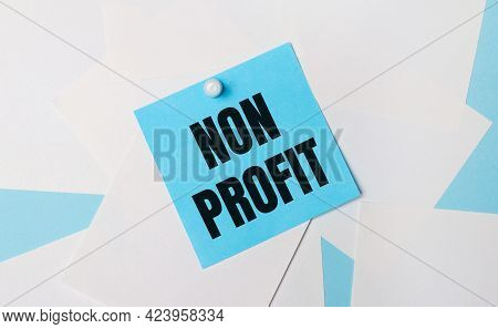 On A Light Blue Background, White Square Sheets Of Paper. A Light Blue Square Sticker With The Text