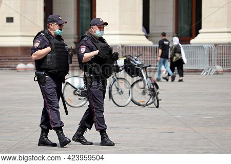 Moscow, Russia - June 2021: Russian Police Officers In Face Masks And Bulletproof Vest Patrol The St