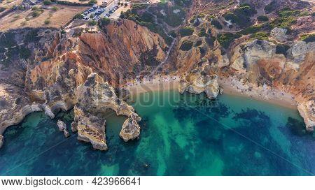 Camilo Beach In Lagos, Algarve - Portugal. Portuguese Southern Golden Coast Cliffs. Sunny Day Aerial