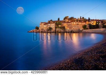 Sveti Stefan Island Near Budva On A Beautiful Summer Night With Moon. Montenegro, Balkans, Europe.