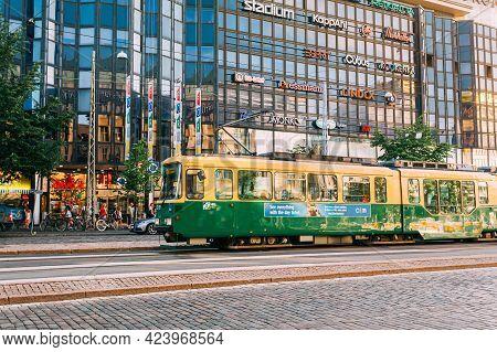 Helsinki, Finland - July 28, 2014: Tram Departs From A Stop On Mannerheimintie Street In Helsinki In