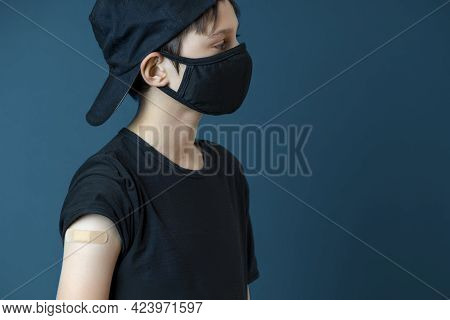 Teenage Boy With Plaster On His Arm After Vaccination. Vaccine And Health Care For Childen And Teena