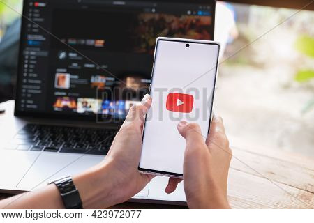 Chiang Mai, Thailand - June 06, 2021 :woman Holding Smartphone Mobile With Video Service Youtube On