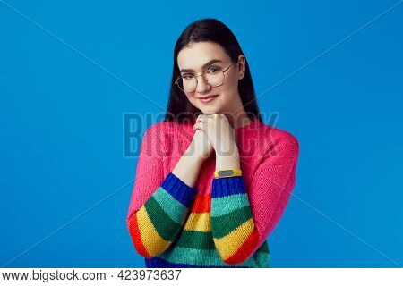 Young Cute Girl Smiles And Keeps Hands Together Awaits For Something Good