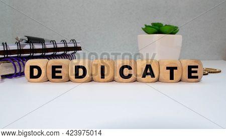 Word Dedicate On A Row Of Wooden Blocks. Devotion Dedication Love Concept