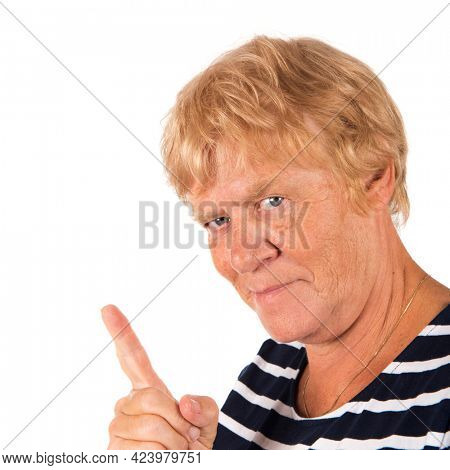 Portrait blonde senior woman with finger for attention on white background