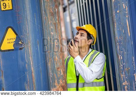 Engineer Or Supervisor Checking And Control Loading Containers Box From Cargo At Harbor. Transportat