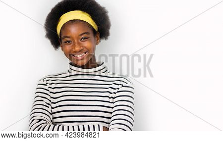 Cute Multiracial African Girl With An Afro Hairstyle Wearing Casual Clothes Smiling - Isolated On A