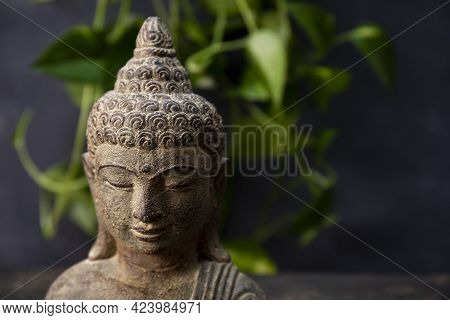 Statuette Of Buddha On A Dark Background Copy Space For Text