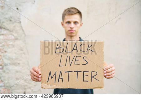 Man Holding Cardboard With The Inscription, Black Life Has Value. Caucasian Guy With A Poster Demons