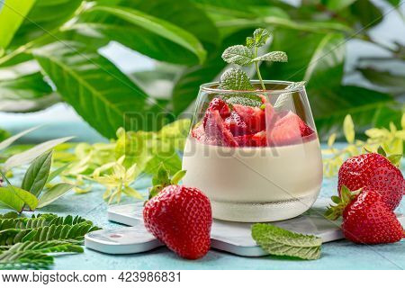 Matcha Green Tea Panna Cotta With Coconut Cream And Strawberry Slices In A Glass. Concept Of A Healt