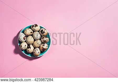 Top View - Quail Eggs And Green Small Plate On Pastel Pink Background. Minimal Happy Easter Composit