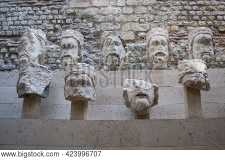 Paris, France Oct 3 2015: Sculpted Stone Heads From The Middle Ages In The Cluny Museum. These Are T