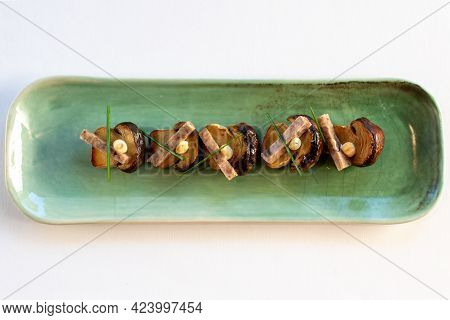 Close Up Top View Of Grilled Porcini Mushrooms With Pork Strips And Garlic Mayonnaise.