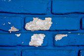 colored and broken blue wall in colonia del sacramento uruguay poster