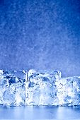 fresh blue toned ice cubes background copy space for the text poster
