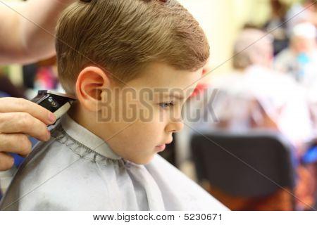 Boy Cut In Hairdresser's Machine
