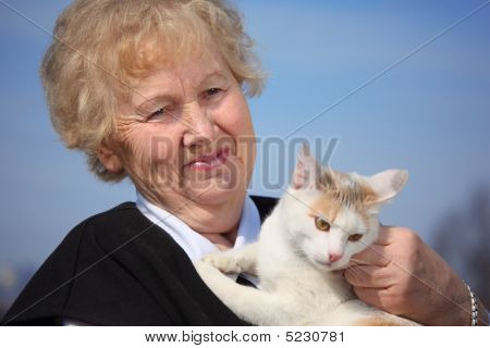 Portrait Of Aged Woman With Cat