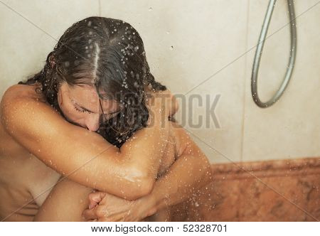 Stressed Young Woman Sitting In Shower