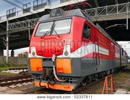 Closeup Photo Of Modern Red Locomotive On Railway Station