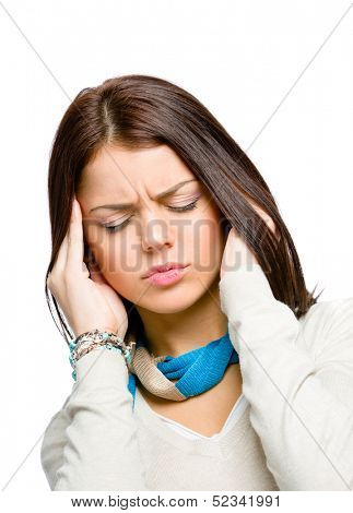 Youngster with eyes closed puts hands on head because of headache or unsolvable problems, isolated on white