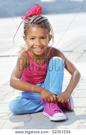 Portrait of a 4 years fashion mulatto girl