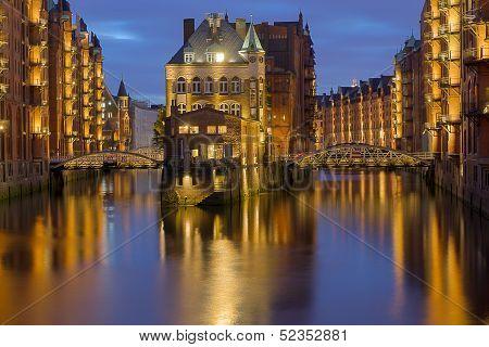 The beautiful Speicherstadt in Hamburg illuminated at night poster