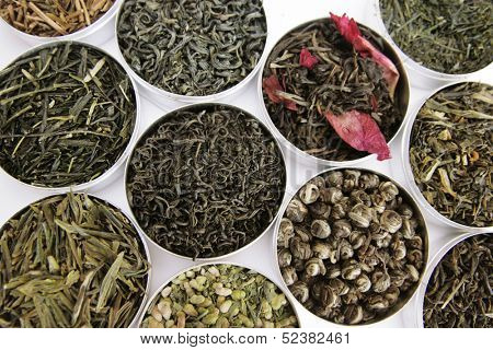 variety of green tea in a little box on white