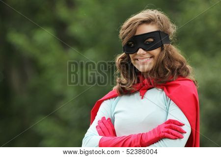 Young woman with red super hero kit smiling