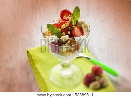 dessert with strawberries and pistachio,  selective focus