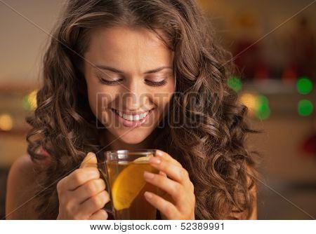 Happy Young Woman Enjoying Drinking Ginger Tea With Lemon