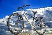 Sports bike on the background of sky clouds and sunlight. poster
