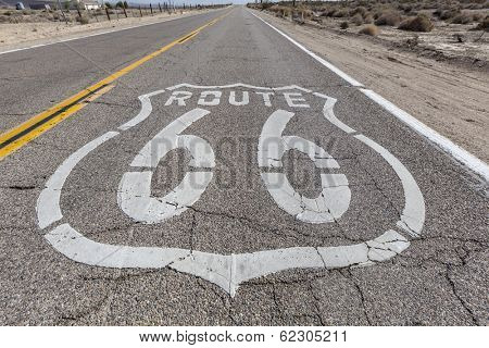 Vintage route 66 highway pavement sign in California's Mojave desert.