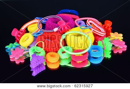 Colorful barrette and Scrunchy isolated on black