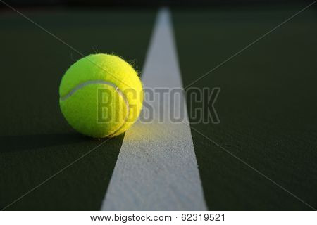 Tennis Ball on the Court Close up with room for copy