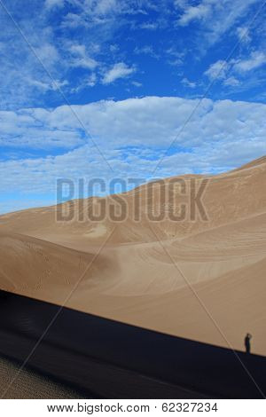 Lone climber with shadow in Sand Dunes