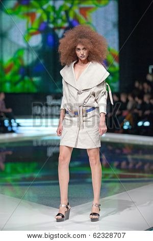ZAGREB, CROATIA - MARCH 28, 2014: Fashion model wearing clothes designed by Marina Design and Marija Ivanovic belt on the 'Fashion.hr' fashion show